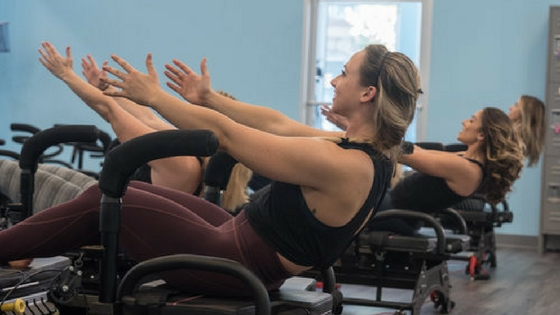 woman works out at fitness studio in philadelphia